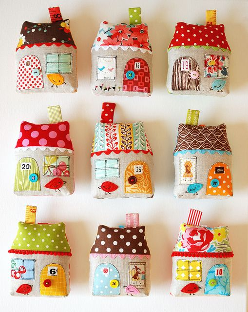 9 houses by Retro_Mama, via Flickr, Retro Mama is awesome! So is Indie Fixx--great place to learn to make something new. LOVE these houses. So I need to break out some holiday fabric, linen and trims and get building.