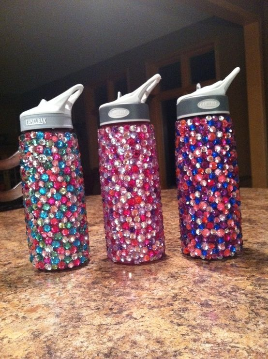 I bought some cute water bottles at Dollar Tree and we decorated them with rhinestones. The girls did their initials, due to time, but I plan on making one like this. We used E6000 epoxy glue. I got the rhinestones at Hobby Lobby in a big tub of assorted colors for 40% off so the cost was minimal. I would recommend for older girls because of the glue.