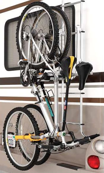 Bikes are held securely on the RV Ladder Mounted Rack with cushioned cradles with integrated retainer straps. Bikes load or unload in seconds.