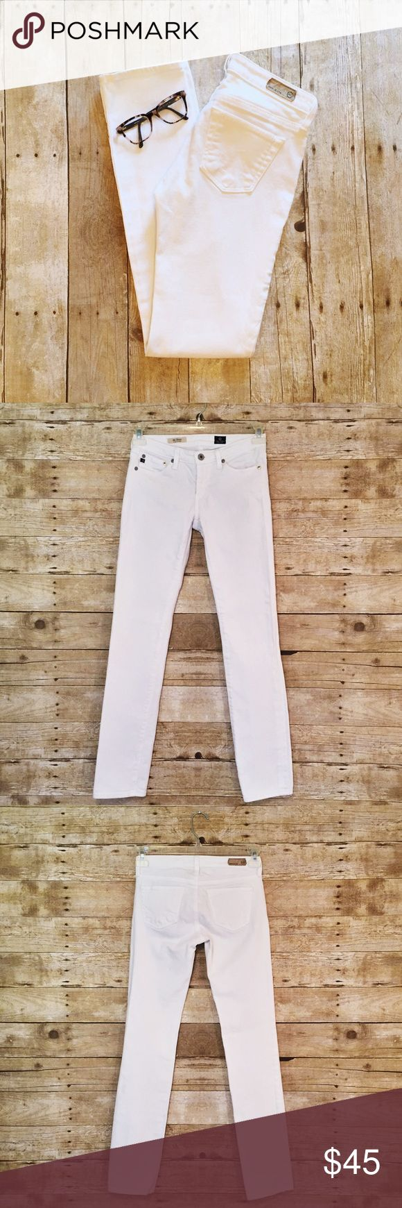 AG Adriano Goldschmied Stevie Slim Straight Jeans AG Adriano Goldschmied Stevie Slim Straight Jeans  - Size 25   - Regular / Standard length  - Slim straight leg  - Zip fly with button closure  - 5 pocket construction  - Cotton blend  - Bright white denim  - Nearly perfect condition  - Only imperfection is small discoloration on back of left leg (pictured); barely noticeable, but could be easily bleached Ag Adriano Goldschmied Jeans Straight Leg