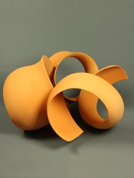 Orange Sculpture - 1259 by Wouter Dam, 2012. Ceramic elements constructed together to make the stunning curve form. #ceramics