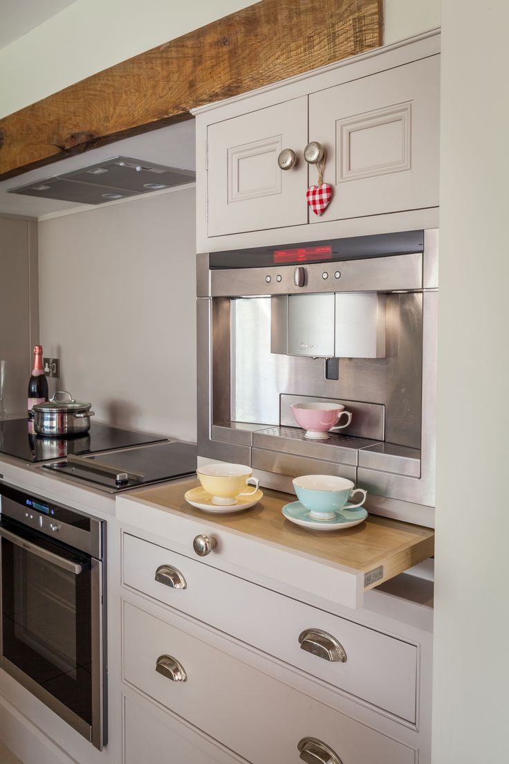 Tea for two? Space-saving modern conveniences set into the units of this quirky kitchen.
