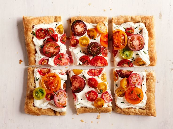 Puff Pastry Heirloom Tomato Tart : An assortment of heirloom tomatoes gives this savory puff pastry a mosaic-like appearance. The more your tomatoes vary in size and color, the better.