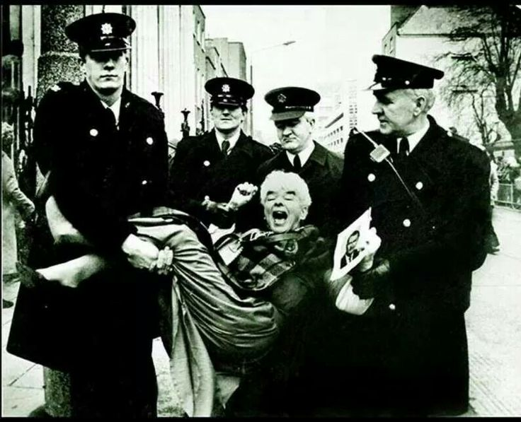 Mary Dunne, a true Dublin character being carried away by Gardai whilst protesting outside the Pro Cathedral, 1985.