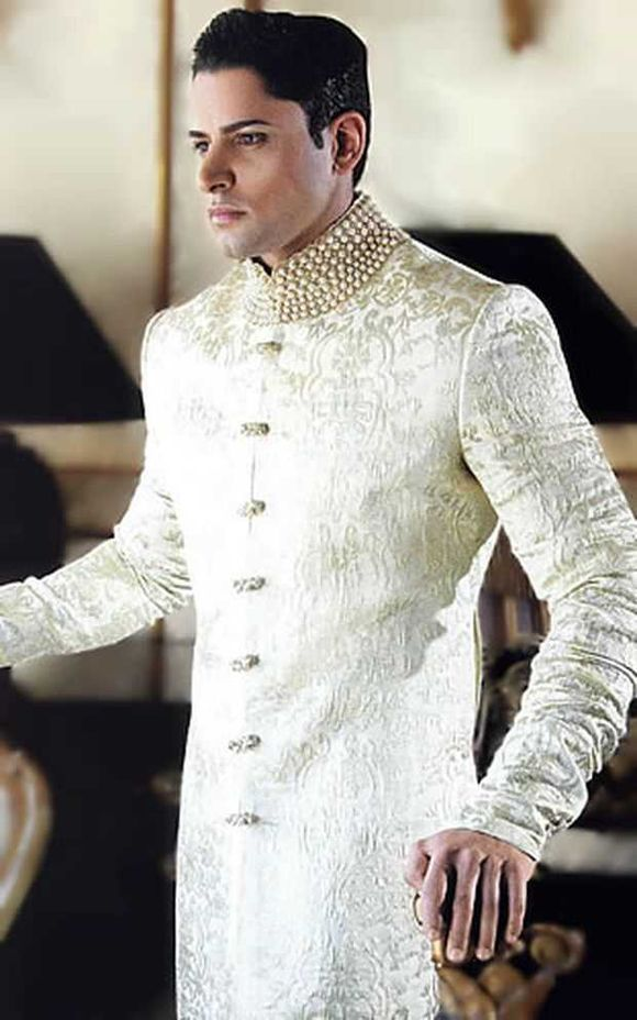 This is the image gallery of Pakistani Stylish Groom Sherwani Wedding Dresses 2014. You are currently viewing Pakitani Men Sherwani Trends. All other images from this gallery are given below. Give your comments in comments section about this. Also share stylehoster.com with your friends.