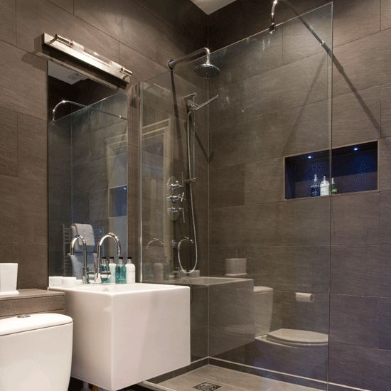 Modernist Shower Room Large Grey Tiles Create An Ultra Modern Look In This Shower Room While A