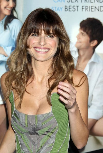 Love the heavy bangs and wavy layers on Lake Bell