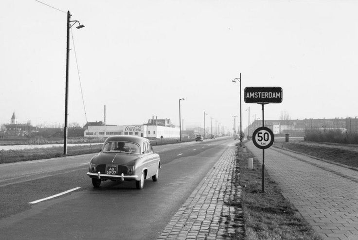 1959. View of the Haarlemmerweg to the west of Sloterdijk. On the left the Coca Cola factory. This factory was established in 1930 and demolished in the 1960's to make room for the construction of the Einsteinweg. #amsterdam #1959 #Haarlemmerweg