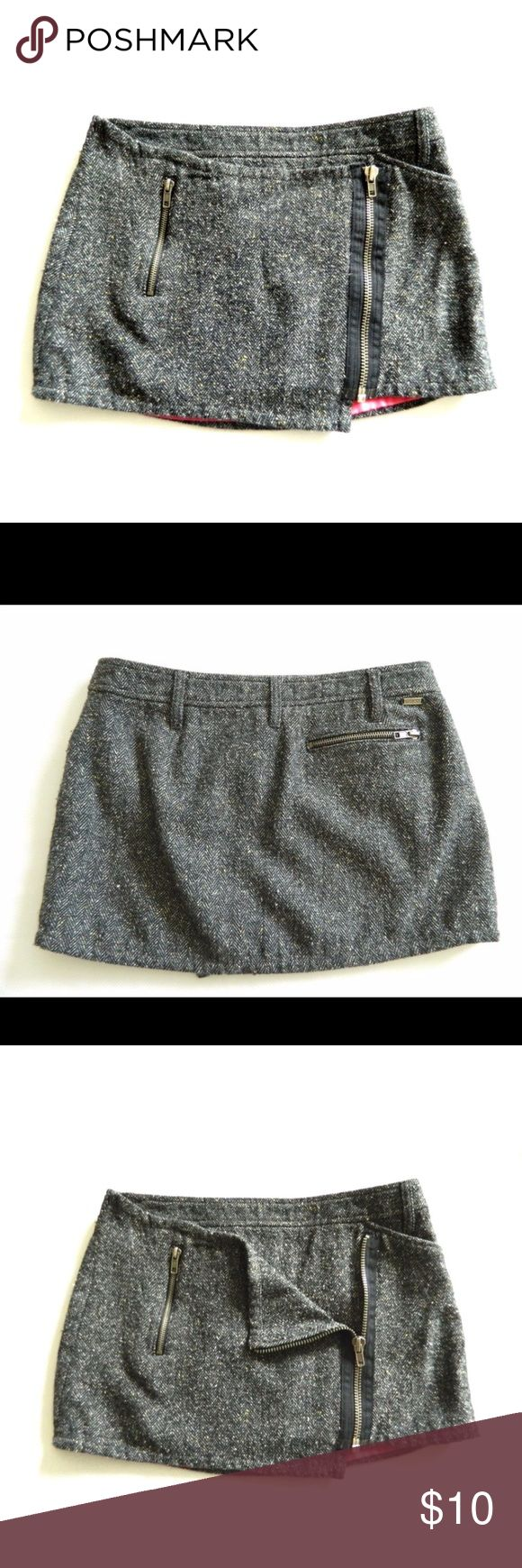 Guess tweed asymmetric micro mini skirt Cute Guess tweed mini skirt. Asymmetric zipper on the front. Worn but in great condition Guess Skirts Mini