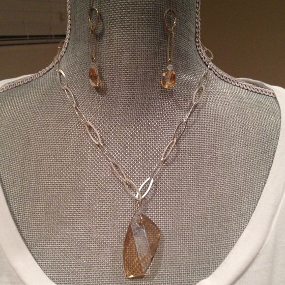 Eric Andrews stone neck/earring set-BOGO 1/2 off Eric Andrews collections. Not sure what the stone is, but it's weighty, light peachy brown and catches the light beautifully. Necklace can be worn shirt or longer. Eric Andrews Jewelry Necklaces