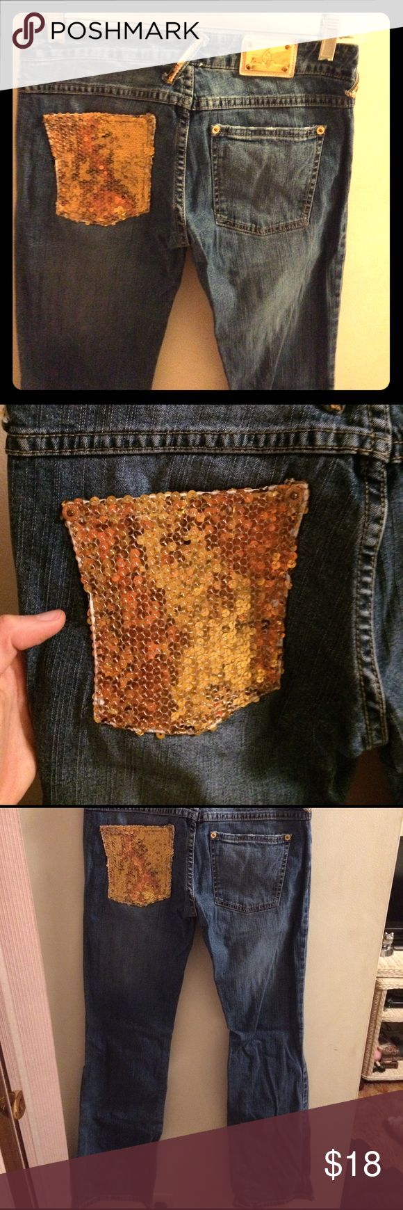 Baby phat size three sequined gold jeans Baby phat size three sequin jeans in excellent condition. Some wrinkles due to storage besides that in excellent shape. Distressed lines seen in last picture. Baby Phat Jeans Boot Cut