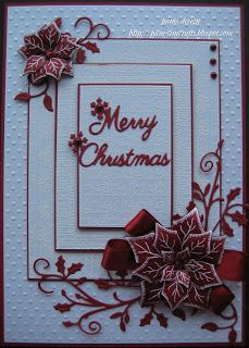 I love the poinsettias, they look frosty.  Card by pamscrafts