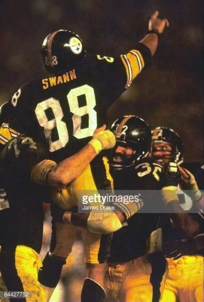 Super Bowl XIII Rear view of Pittsburgh Steelers Lynn Swan victorious getting carried off field by teammates after winning game vs Miami Dolphins...