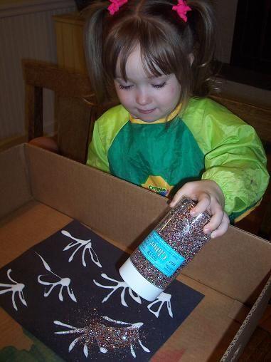 Glue + construction paper + glitter = fireworks.