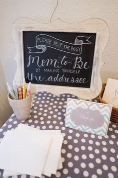 Baby Shower Idea - chalk board sign and station for guests to address their own thank you cards