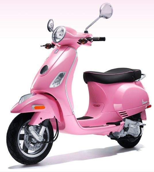 I drive a pink Vespa LX 50 scooter.  I LOVE IT!