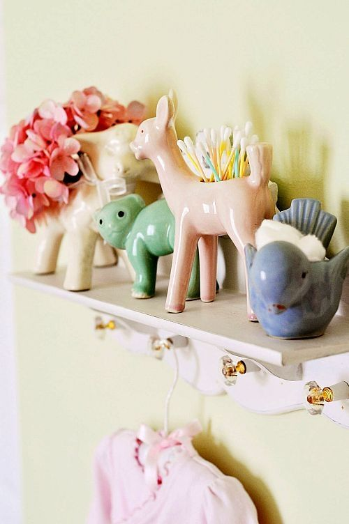 vintage planters holding baby care items Use them for décor at the baby shower and then use them to hold items on shelves or dressers in the nursery