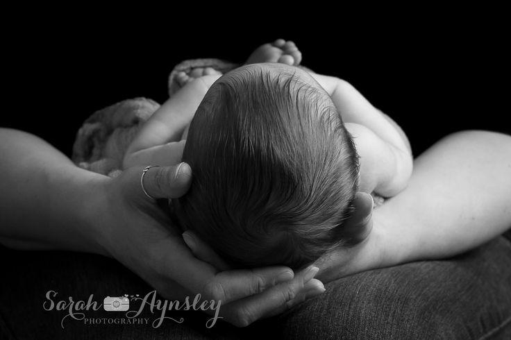 newborn in mother's hands www.sarah-aynsleyphotography.com