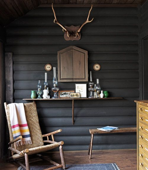 Cabin interior: dark grey wall with blanket