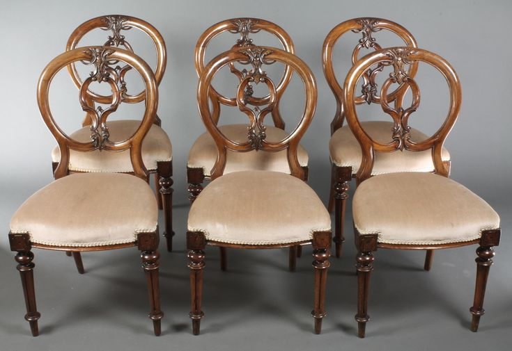 Lot 1025, A set of 6 Victorian carved walnut balloon back dining chairs with over stuffed seats, raised on turned and fluted supports, sold for £260