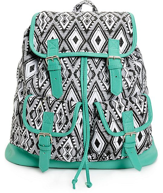 Keep all your gear organized with the style of this medium size rucksack backpack made with a black and white tribal print canvas exterior and contrast mint faux leather trim.