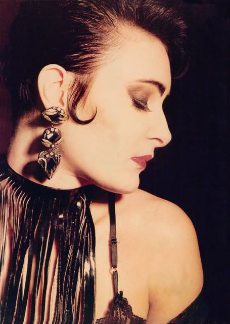 Siouxsie Sioux. Huge heart shaped drop earrings.