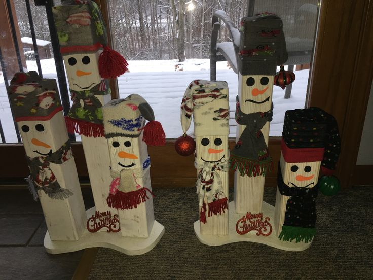 Snowmen I made using old 4x4 lumber and some old Christmas socks