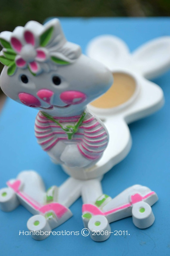 I still have my rabbit pin.  I loved it and the lip balm inside!