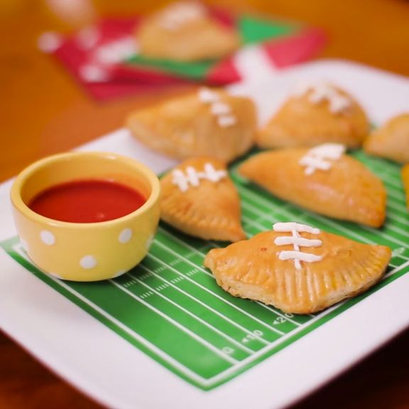 Mini Football Buffalo Chicken Calzones are sure to be you Game Day MVP.