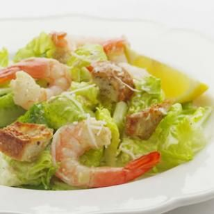 While most Caesars drown the greens in a heavy dressing, this lemony version lets the taste of the shrimp shine through.