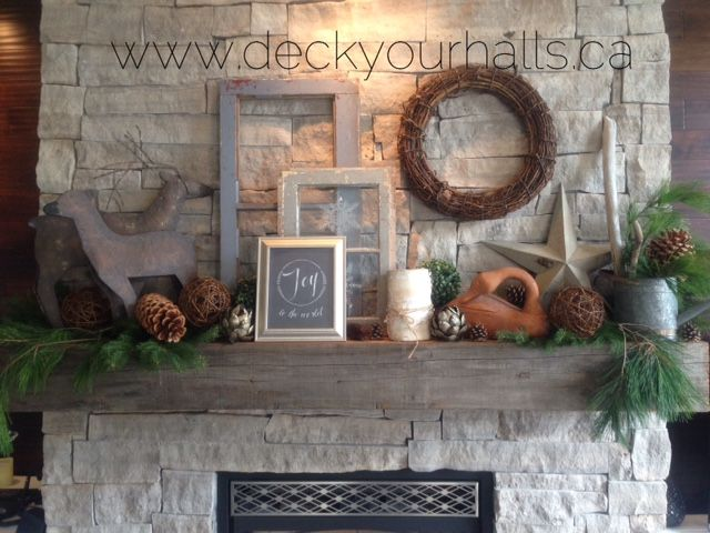 A casual rustic look.  Always on trend.  Galvanized water can, weathered window panes, some greens and a couple of deer!