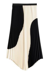 Check this out! Calf-length skirt in crêped, woven fabric with an elasticized waistband, pleats, and rounded hem. - Visit hm.com to see more.