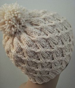If you've always wanted to learn how to knit a hat, set your sights on the Wickerwork Hat. Complete with an adorable yarn pom pom, this easy knit hat pattern is perfect for young and old alike.  #Knit #Pattern #Free