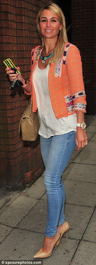 Love this coral Aztec influenced jacket with nude accessories!