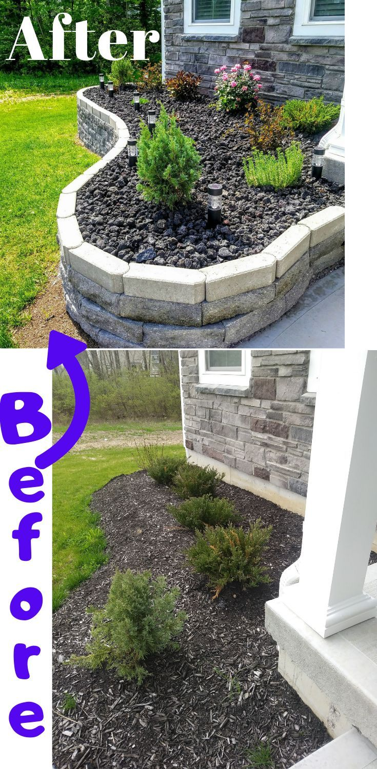Flower bed idea with black lava rock and retaining wall