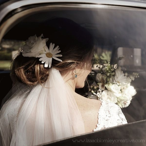 boho wedding bride in vintage car and floral hair piece