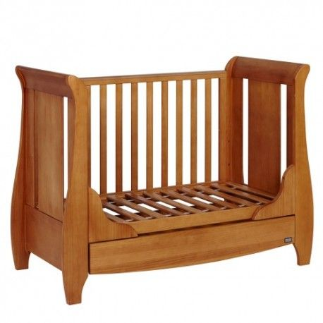 This Oak Cot Bed is made of solid oak. This cot bed has smooth panels with a lovely finish and is designed to grow with your little one easily converting into a junior bed a sofa bed and has a full length under bed drawer.  Suitable from birth up to 4 years Converts into a junior bed and a sofa bed Three position bed base  Full length under bed drawer on wheels  Dimensions are :  Length : 138 cm Width: 67 cm Height : 102 cm Footboard Height : 33 cm