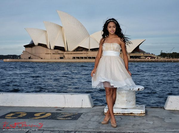 Blue water and the Sydney Opera house as a backdrop to this Special XV Dress & Birthday portrait in Sydney. Photographed by Kent Johnson.