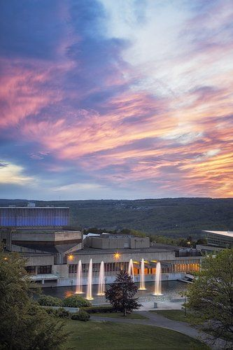 A sunset view of the fountains and Dillingham Center. Ithaca College