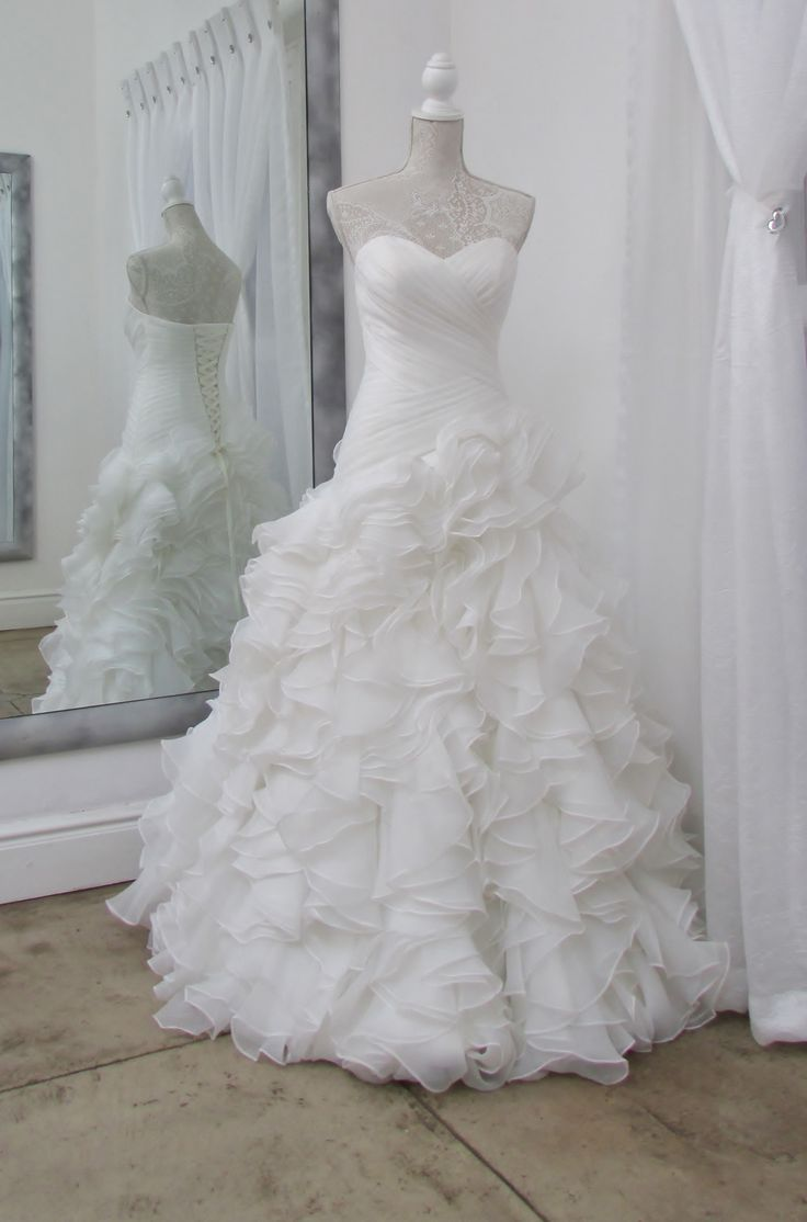 Traditional bridal gown with a modern touch....this dress looks amazing....our customers love the fit of this gown.....