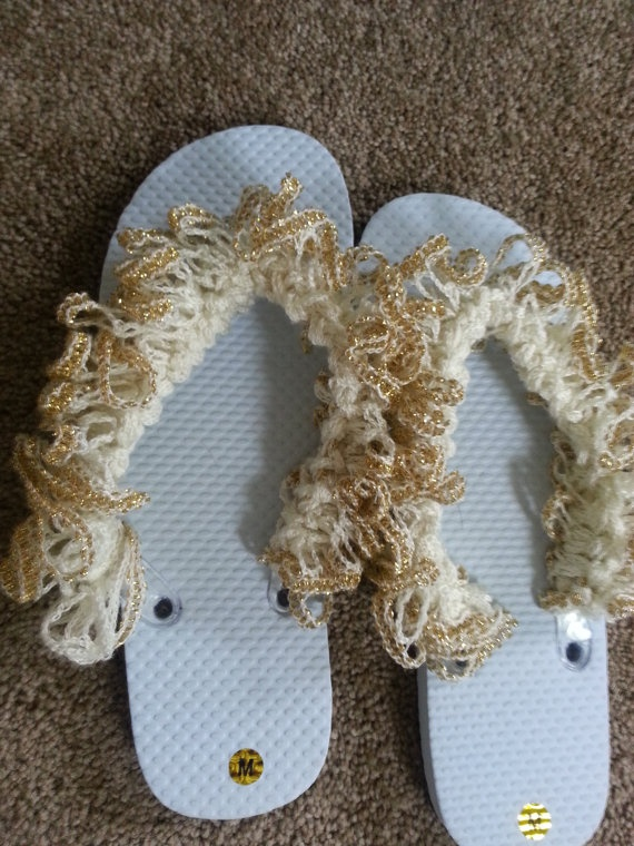 Flip flops with crocheted with ruffle yarn.