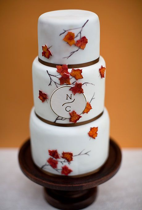 The design of this cake—inspired by a fall-themed invite by Wedding Paper Divas—is embellished with handpainted branches, gumpaste leaves, and a modern monogram. @Rachel Claire