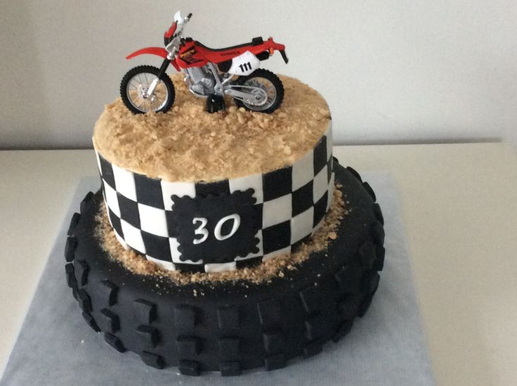 just top part of cake with a dad bike and baby bike ♡