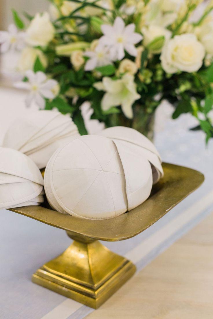 Yarmulkes on Gold Stand  Photography: Liz Banfield Read More: http://www.insideweddings.com/weddings/sophisticated-playful-southern-jewish-wedding-in-charleston/1076/