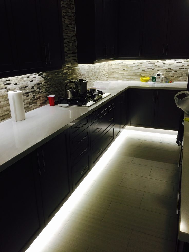 Under cabinet and footwell led strip lighting. Also hidden counter top  receptacles