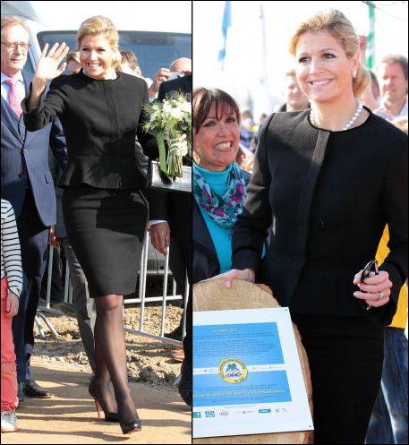 Máxima in zwart mantelpakje van modehuis NATAN, gecombineerd met zwarte Louboutins