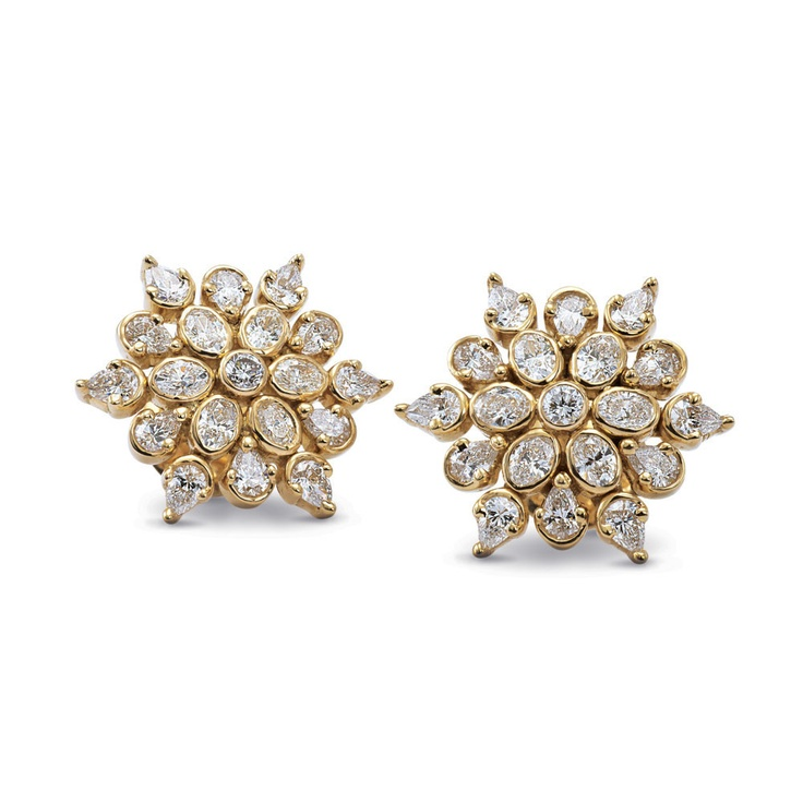 Our pick for the day is Rasvihar Charanam. Finely detailed diamonds set in a delicate floral motif make these earrings fit for a queen.