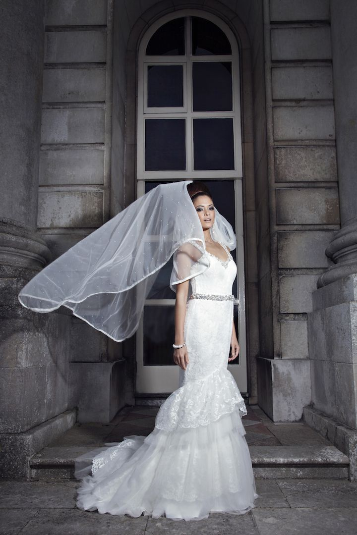 White wedding dress designed and created with Chantilly Lace and tulle embellished with pearls and crystals
