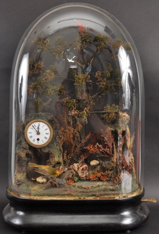 A SUPERB VICTORIAN AUTOMATON CLOCK with five birds tweeting and jumping from one branch to another, a waterfall to one side, the clock with circular drum movement, with glass dome.
