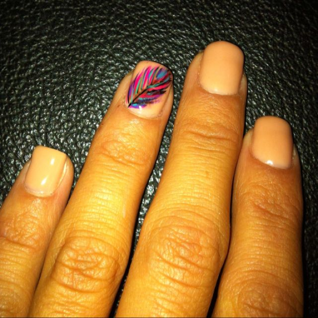Feather nail. Create by using different nail polish colors and a toothpick?
